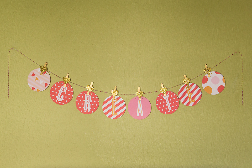 Create banner with DIY gold glitter heart clips.