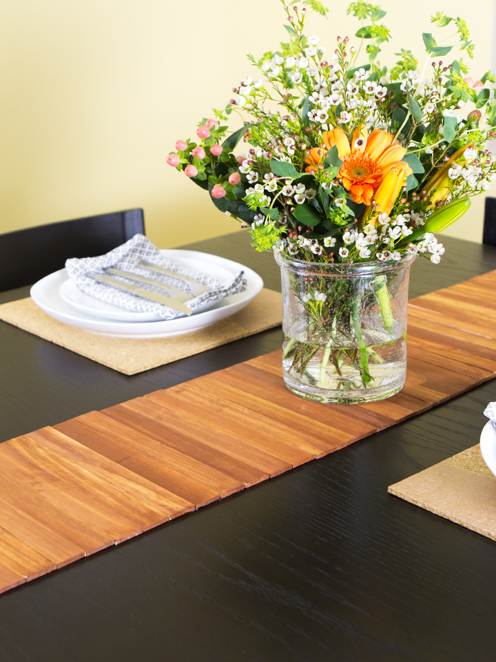 Another great use for paint stir sticks. Learn how to make a table runner in this video tutorial.