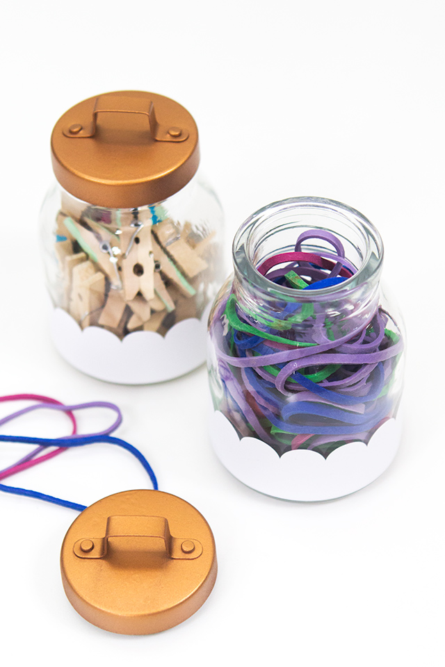 Use some adhesive vinyl and spray paint to transform regular jars into oh-so-cute storage containers. Perfect for stashing office supplies!