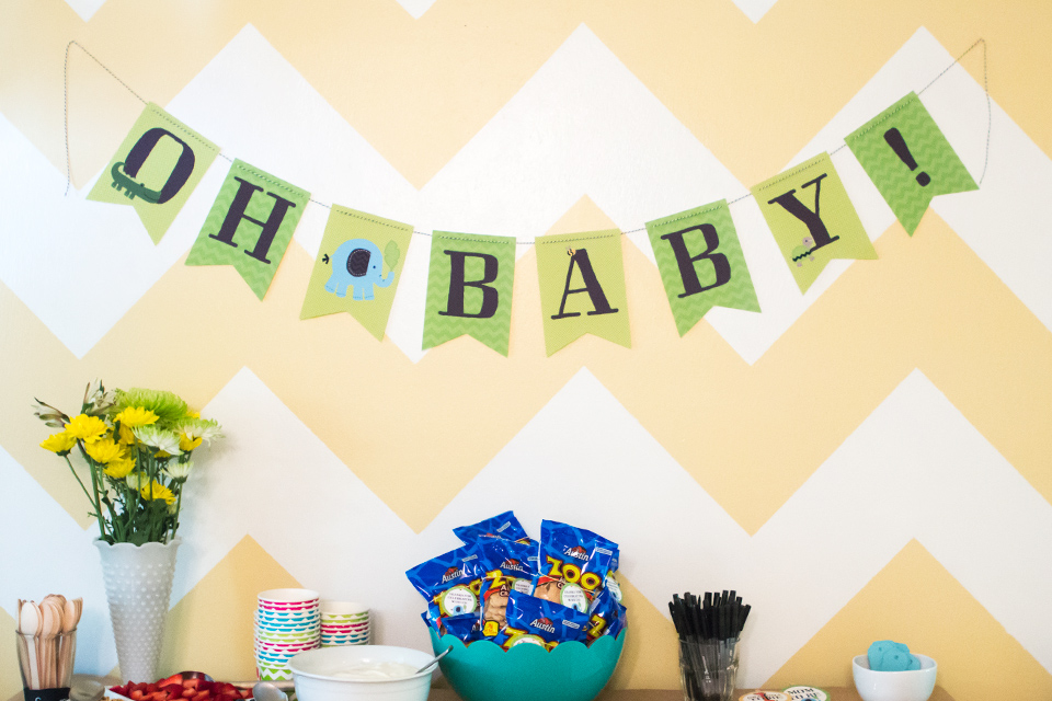 Download and print this adorable free jungle themed baby shower banner. Perfect for hanging above a dessert or gift table.