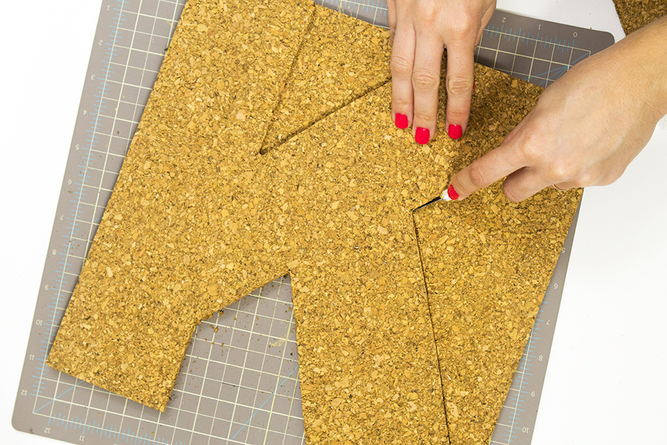 Use cork titles to create a monogram cork board. Love this idea for my entry way table.
