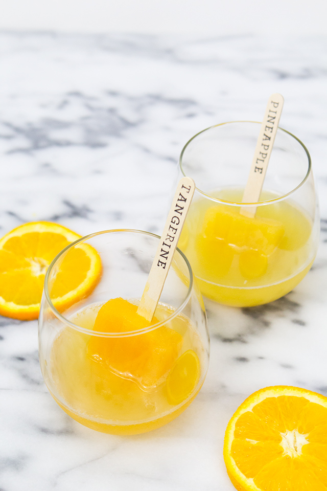 This version of mimosas is so much more fun than traditional ones! Love the idea of using assorted orange juices like pineapple and mango orange. Yum!