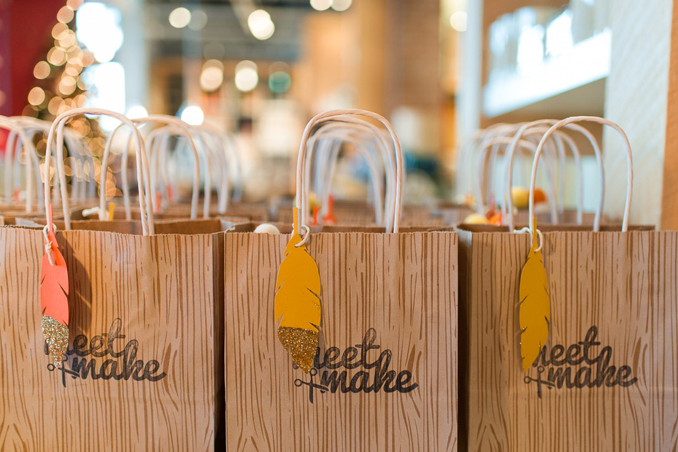 Swag bags filled with fall inspired goods! Love the gold glitter dipped feather.