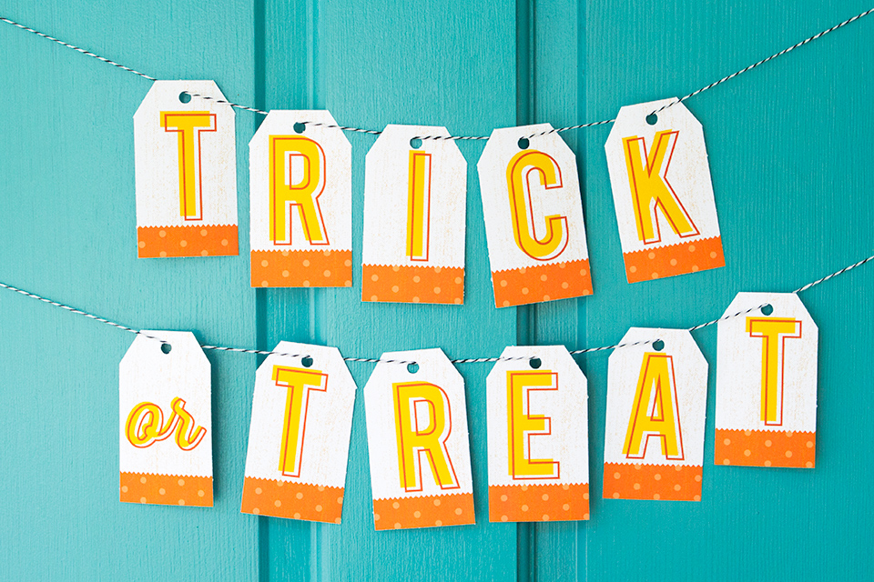 Use this free printable banner to greet trick or treaters or as simple party decor this Halloween.