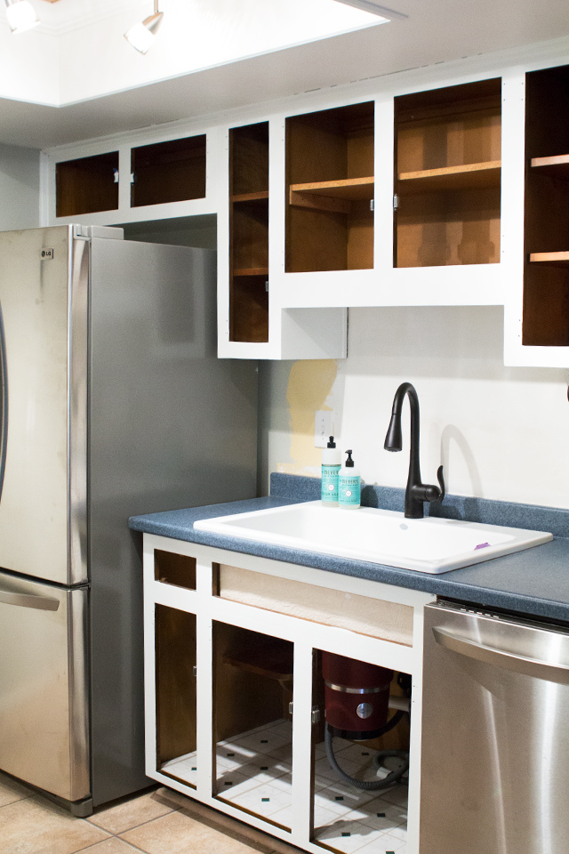 Learn how to paint kitchen cabinets the right way! This post is loaded with great tips.