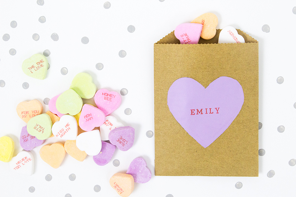 These DIY painted conversation heart treat bags are just so cute!