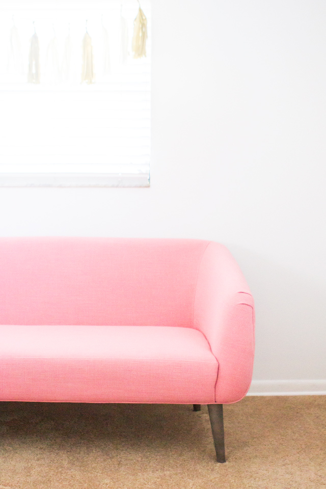 Love love love this mid-century modern pink sofa. Such a cute way to add some girly charm to a space.