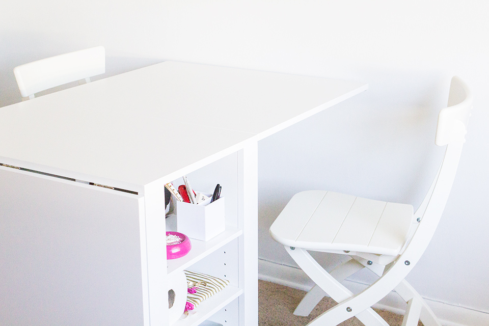 This hobby table is just what I need in my tiny home. It can be tucked away when not in use and expands to seat four.