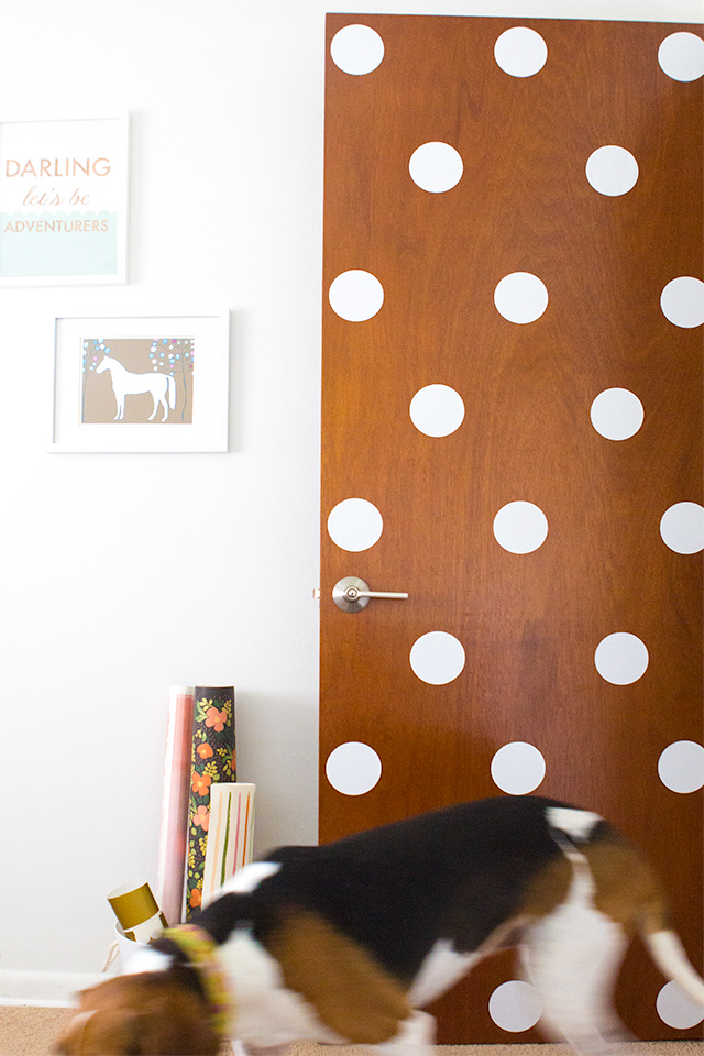 If you have plain front doors in your home you can dress them up by adding vinyl polka dots! Perfect for rentals too.