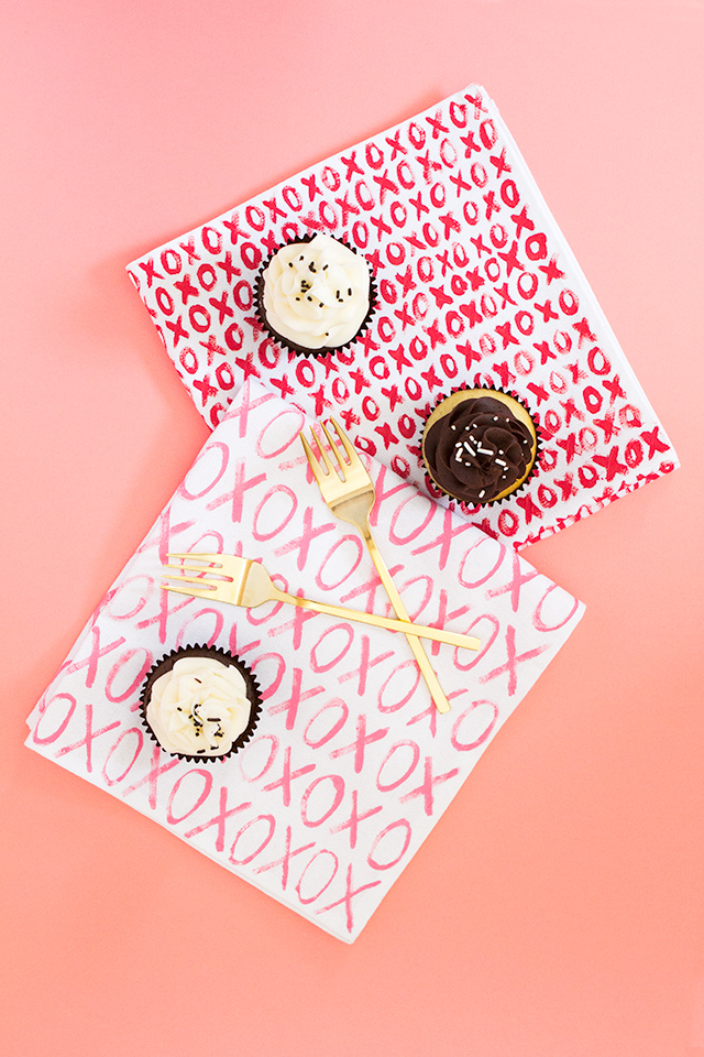 You don't need to be an artist to make your own Valentine's Day dinner napkins. Use a small angled brush to paint X's and O's all over white cotton napkins.