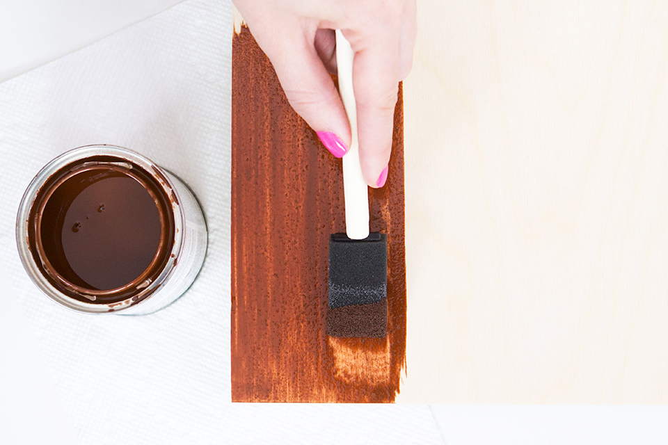 Paint a wood panel board with wood stain to create your own geometric wall art (click through to see the final piece).