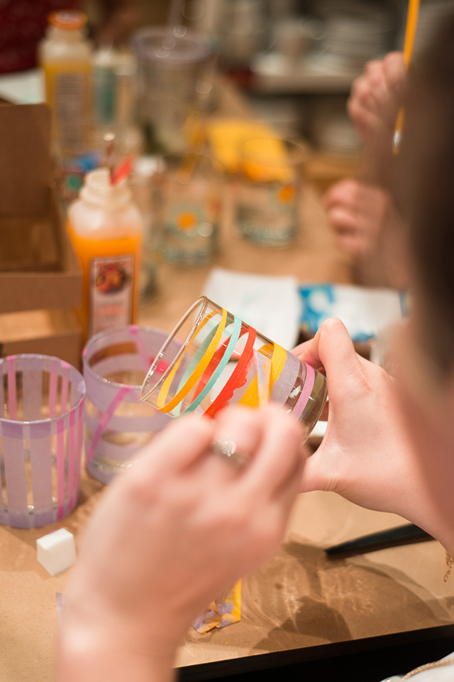 Use thin washi tape and glass paint to create beautiful striped glassware.
