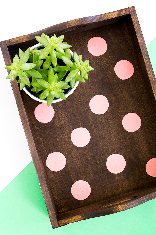 Love this DIY polka dot wood tray! It's such a simple project that can be used for serving food, on a bedside table, or even on a coffee table.