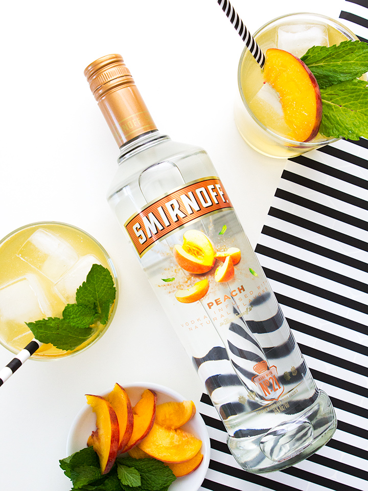 Smirnoff Peach makes the perfect liquor for summer punch. Click through to see what's in this delicious easy to make recipe.