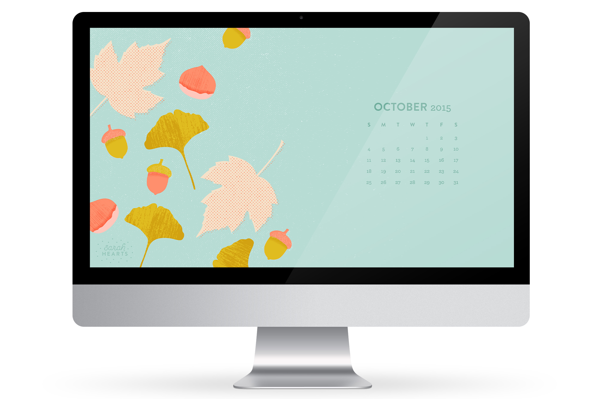 Add a bit fall to your desktop with this free October 2015 calendar wallpaper by Sarah Hearts! (Click through to download for all devices)