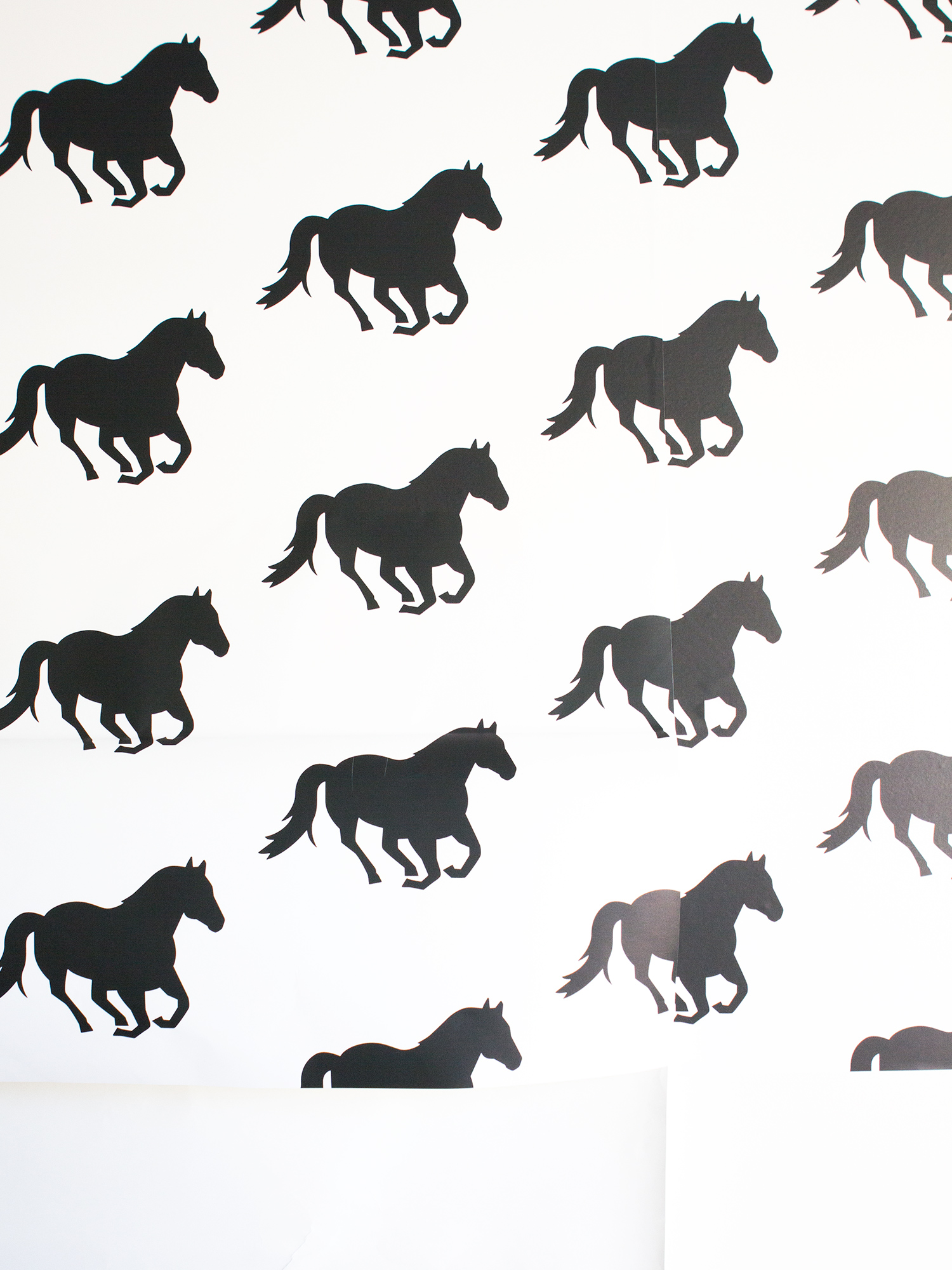 See how blogger Sarah Hearts gave her office a temporary update with a horse print peel and stick wallpaper! (Click through for tips and tricks on how to apply it)