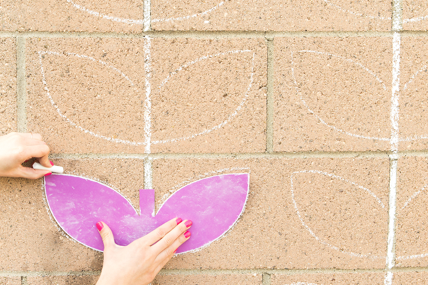 Use chalk to create a pretty pattern on a cinderblock wall!