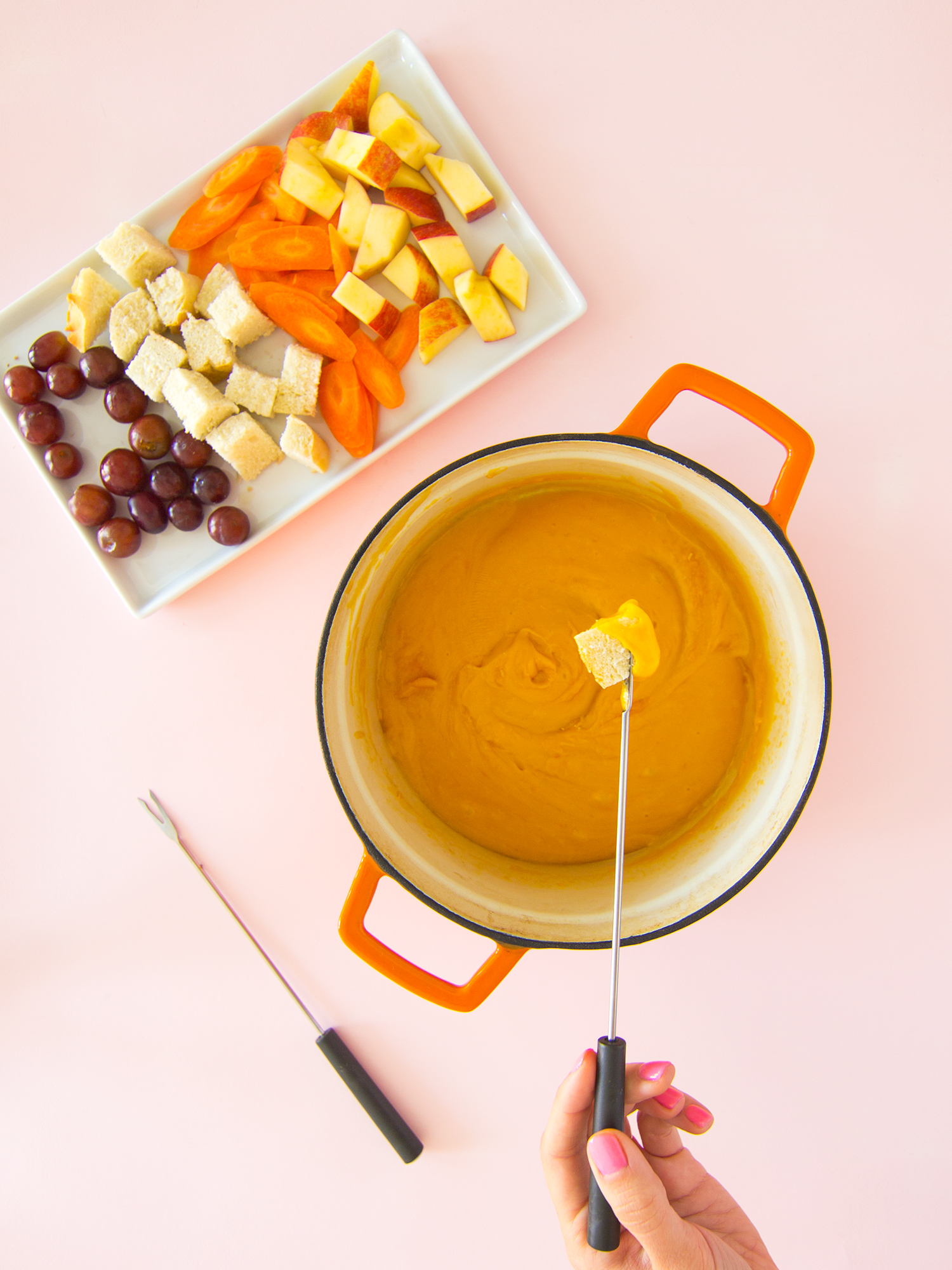 Have a date night at home and make these delicious cheddar cheese fondue! No special fondue pot required!
