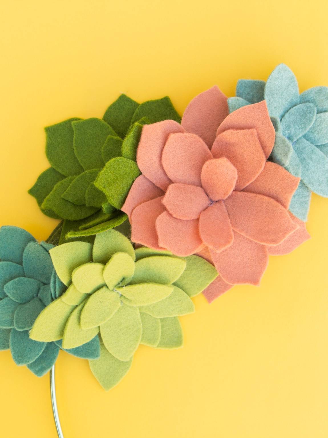 Regular felt sheets get transformed into gorgeous succulents! Click through to see how to make your own faux succulent wreath using your Silhouette Curio.