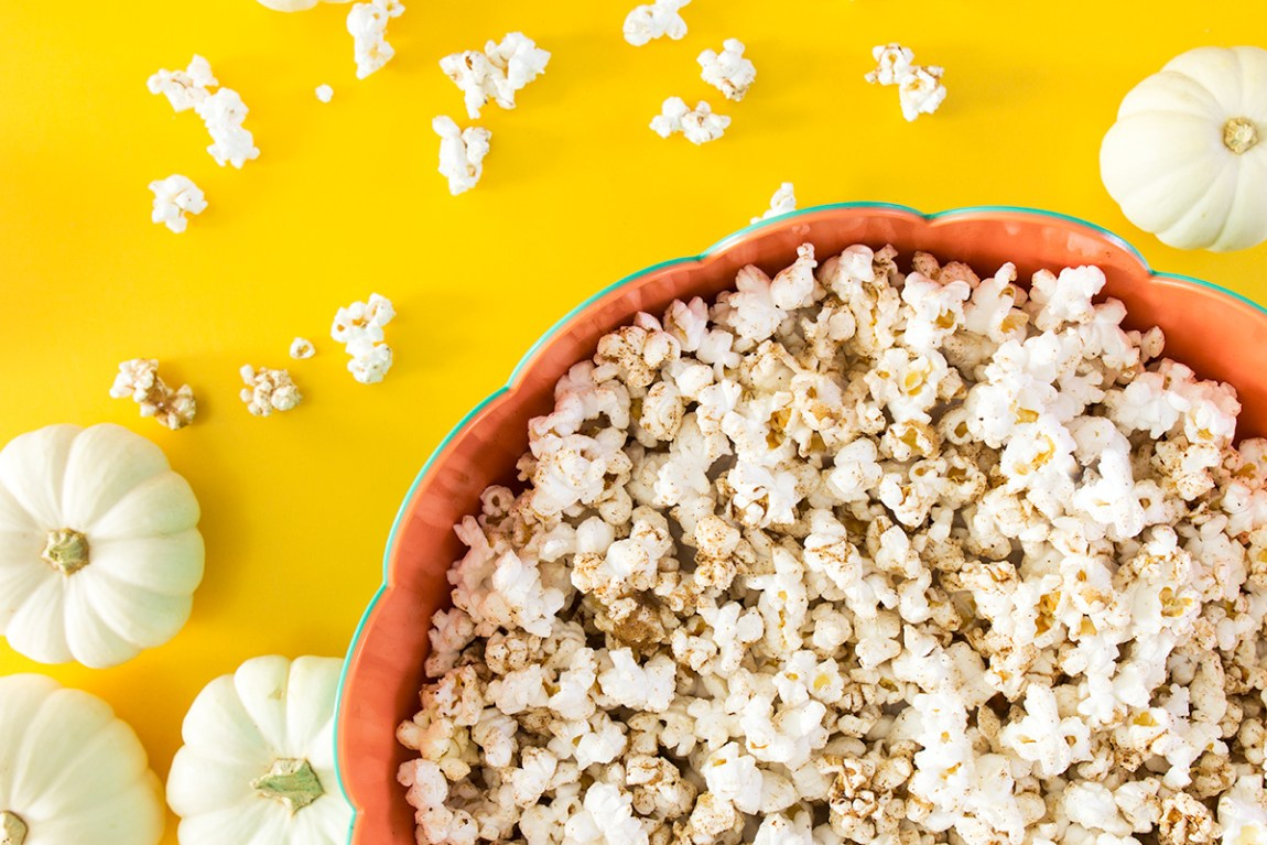 If you love pumpkin spice lattes then you will love this sweet and savory snack! This pumpkin spice popcorn recipe only takes 5 minutes to make!