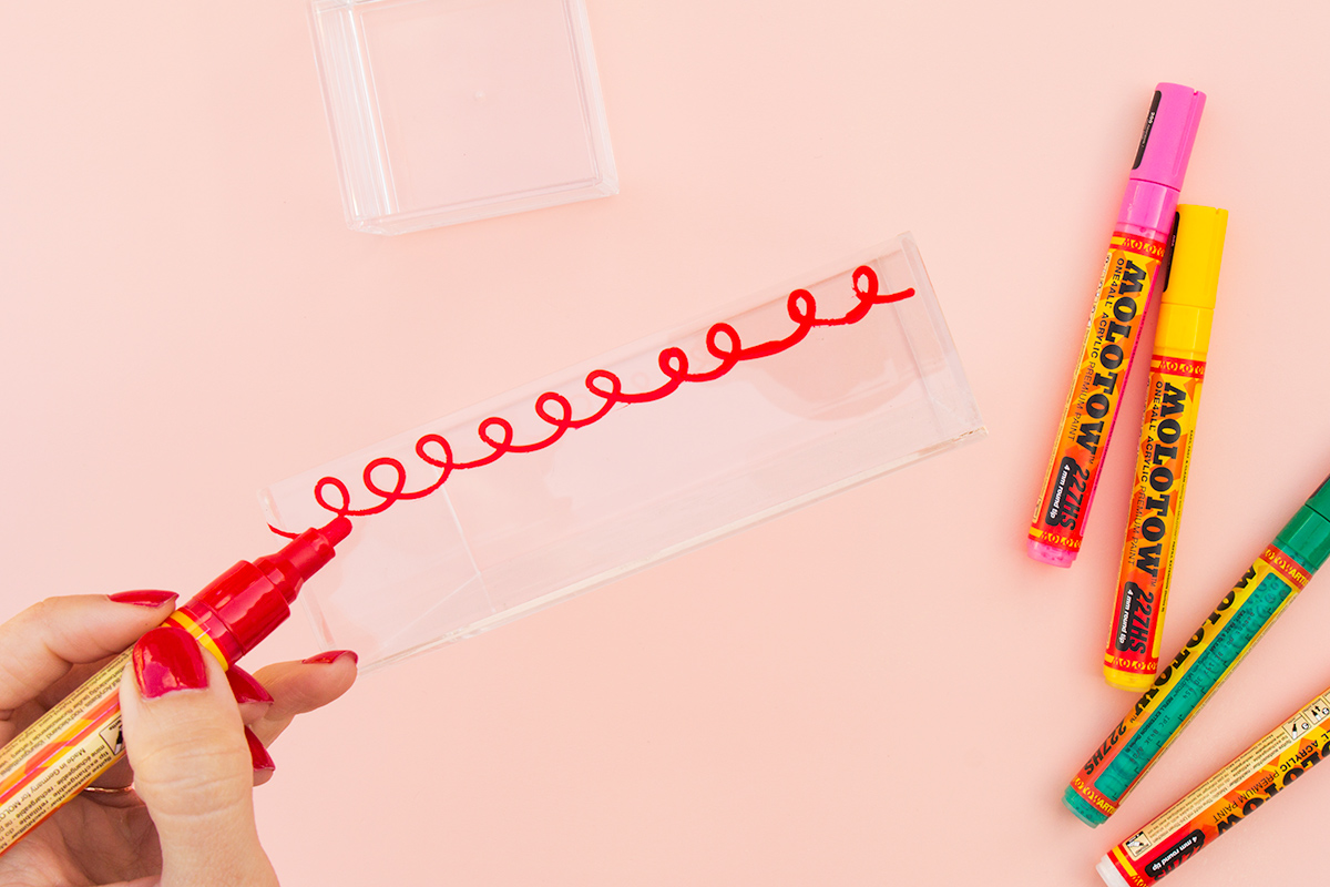 Use paint pens to doodle on acrylic and create custom trays for food and knick knacks.