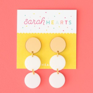 Photo of white and mirrored gold acrylic circle earrings