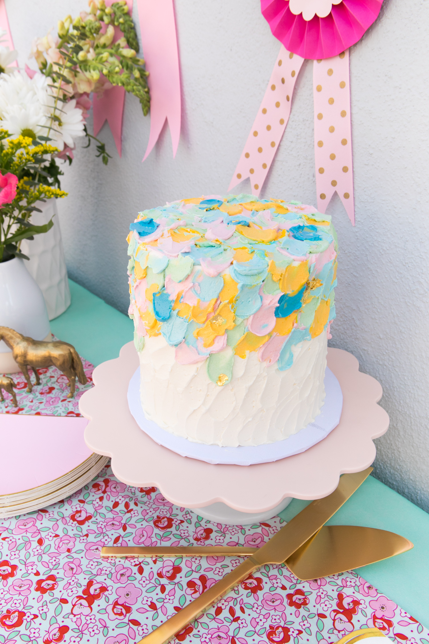 A Beautiful Multi Colored Pastel And Gold Leaf Red Velvet Cake