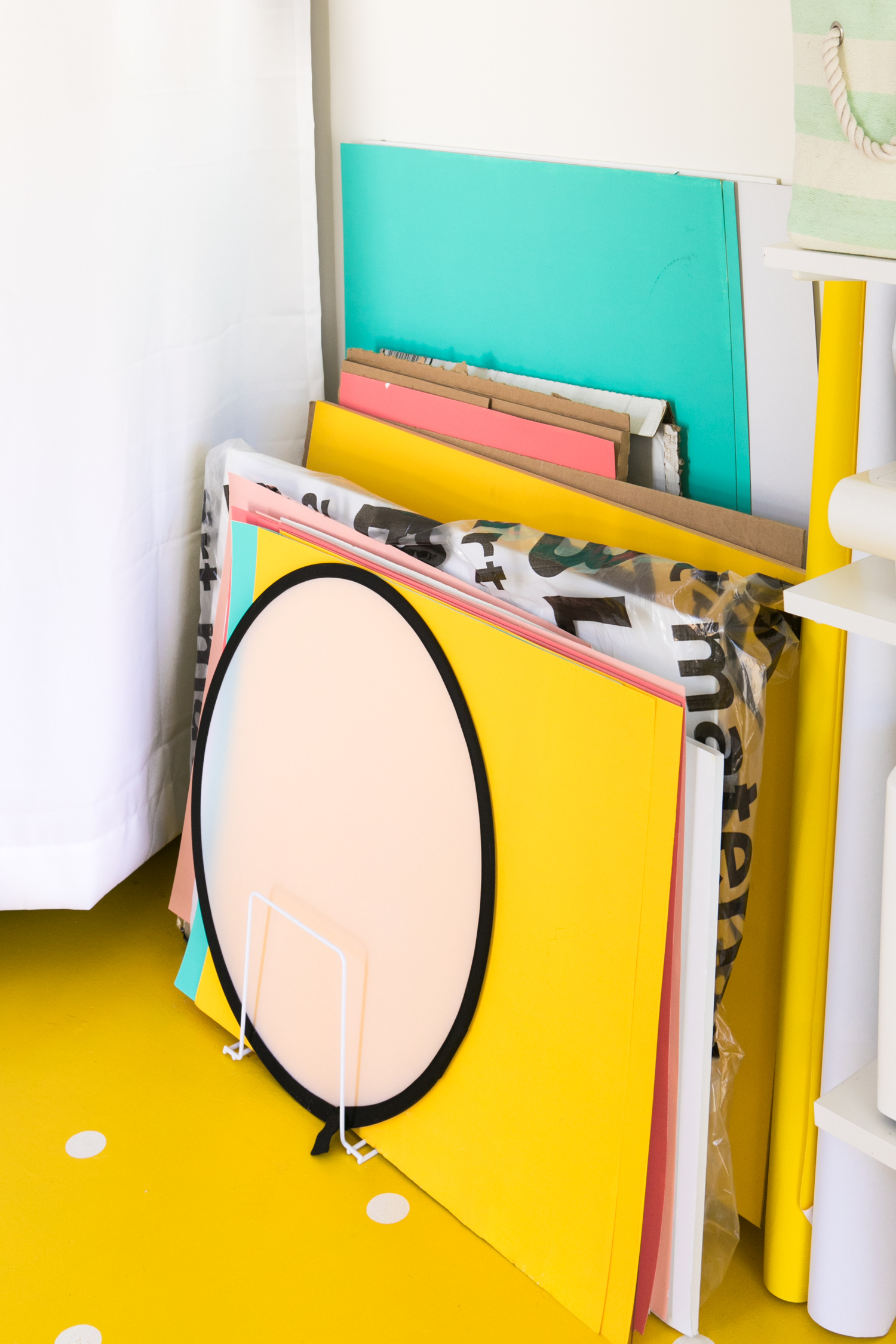 use a kitchen organizer to keep backdrops and poster board tidy