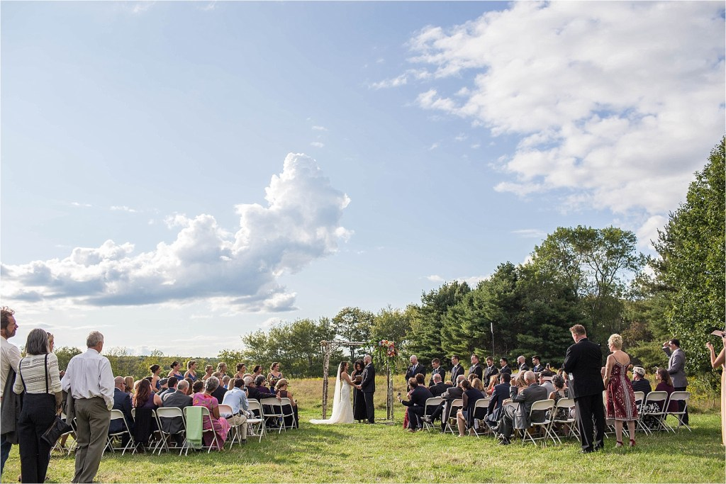 Wedding Ceremony in field at Gisland Farm Maine