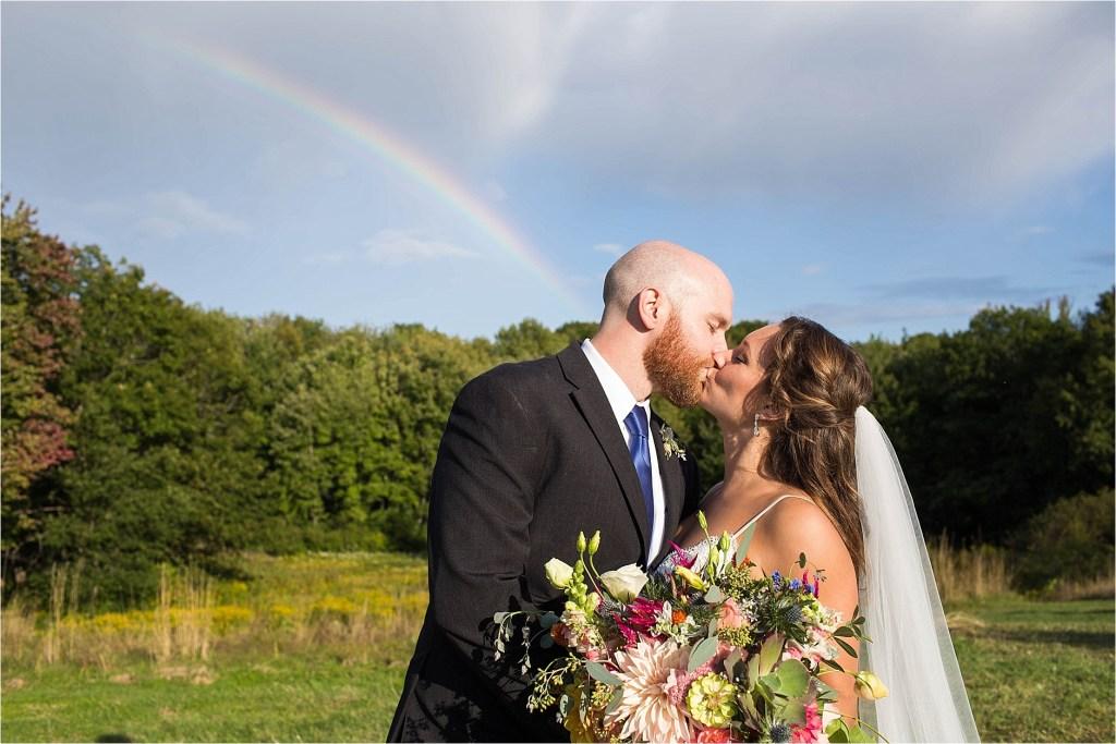 Bride Groom Kissing Maine Wedding Rainbow in the Sky