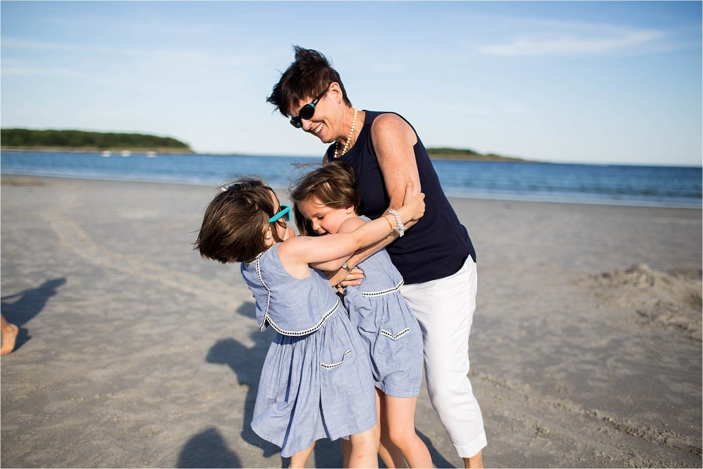 Grandmother playing with grandkids on the beach Goose ROcks Beach Kennebunk Maine