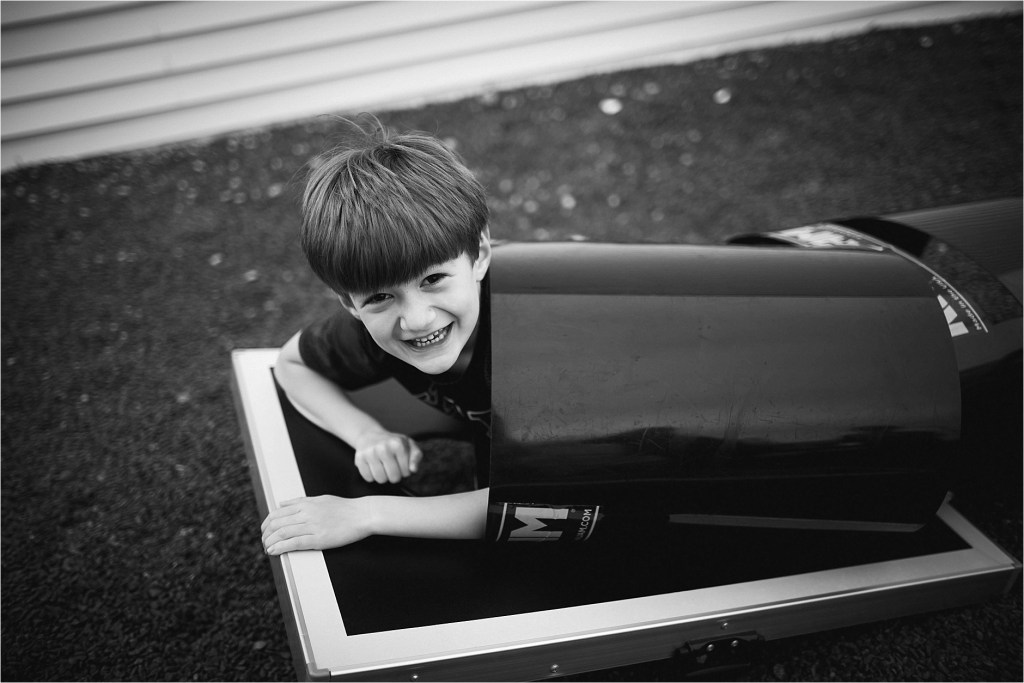 hiding in a tube black and white portrait of boy hiding in a tube York Maine Long Sands Beach
