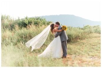 wedding couple kissing after wedding