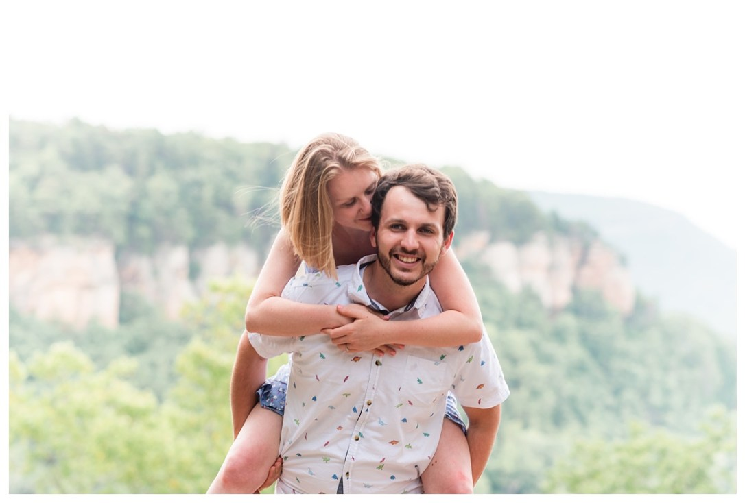 piggy back ride at engagement photo session