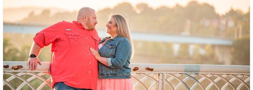 couple talks at sunrise on the bridge