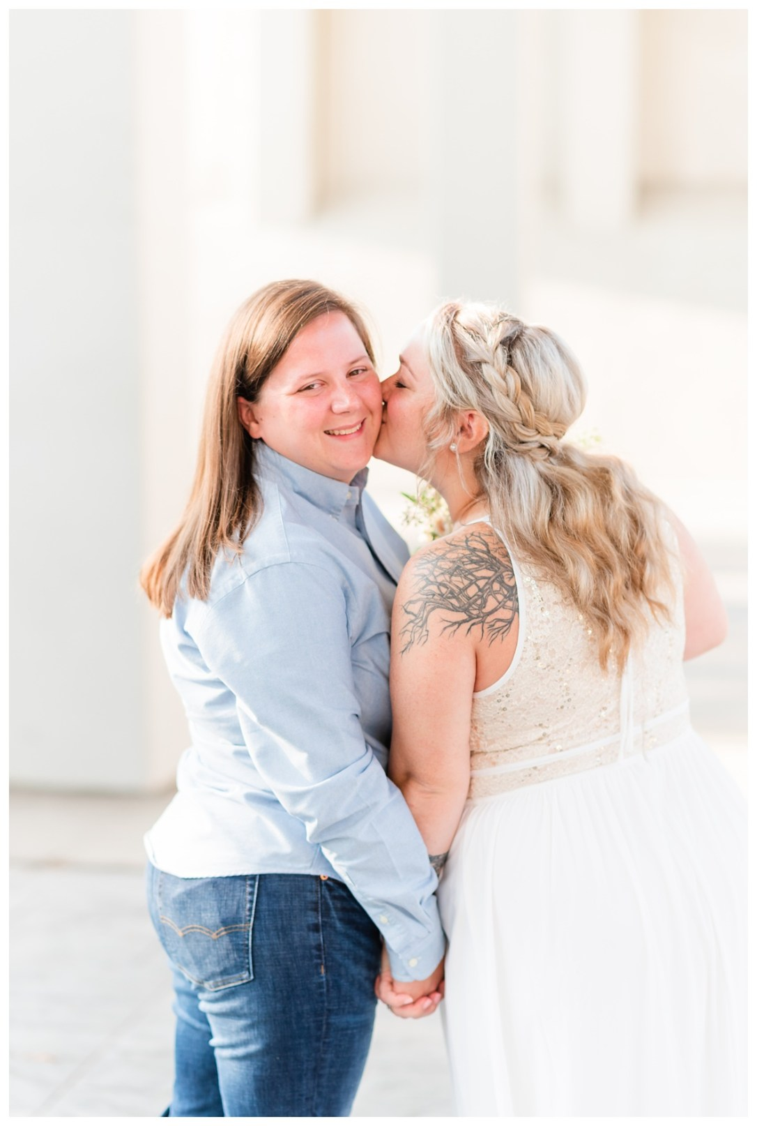 chattanooga lesbian couple share a kiss on their wedding