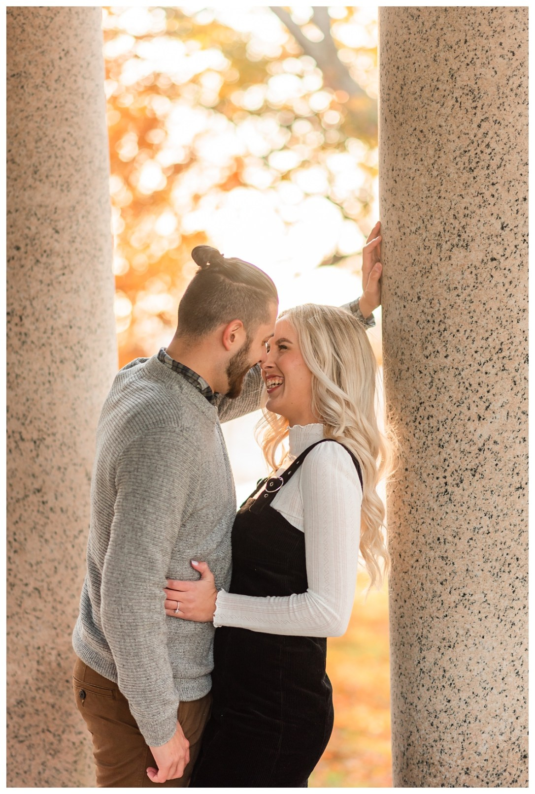 couple snuggles and laughs for engagement photos