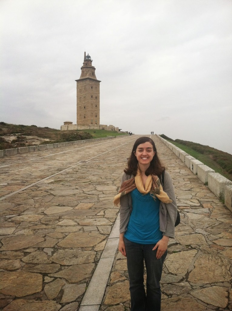 Standing on a path in front of the Torre de Hércules in Coruña, Spain