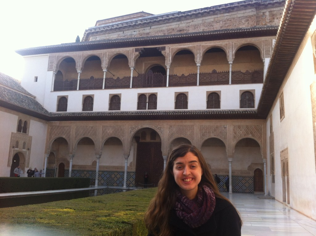Posing for a photo in the main courtyard of the Nasrid Palace in Granada, Spain