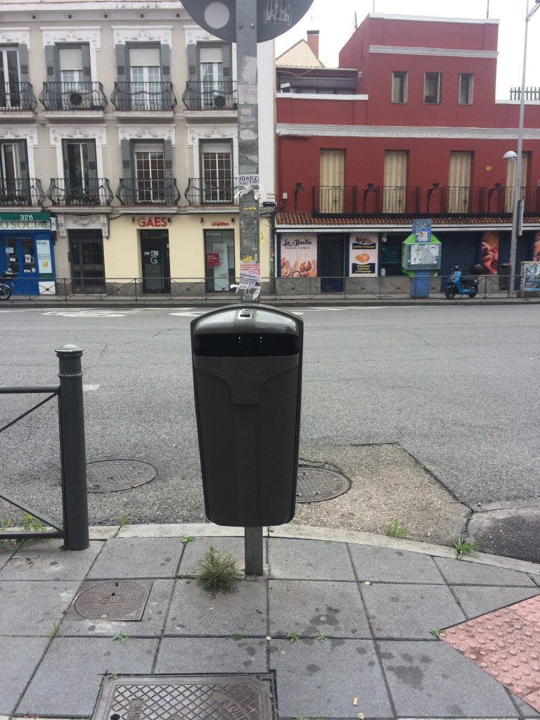 Normal trash can for paper on street