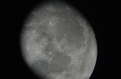 The moon through a telescope eyepiece