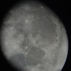 The moon through a telescope eyepiece