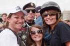 Sarah and Willow posing with others at Rolling Thunder