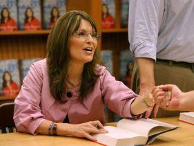 Sarah in pink jacket at Villages book signing