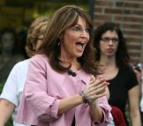 Sarah in pink jacket reacting to fans cheering at Villages book signing