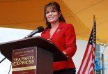 Sarah at podium at TPX rally NH