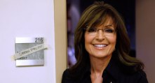 Sarah smiling outside Matt Lauer's dressing room - her name across nameplate