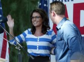 Sarah waving during speech at Kirk Adams rally