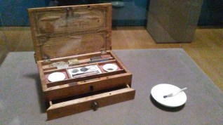 Charlotte's paint box. The paints were contained in the pressed domino-like disks in the back compartment. By adding water, the painter could create watercolor paints.