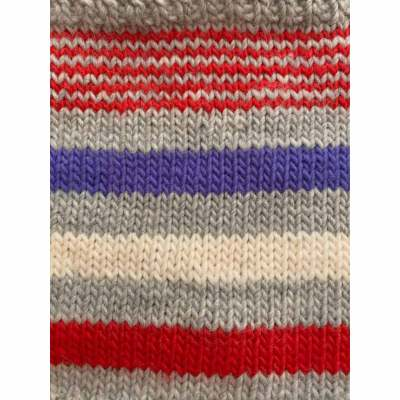 knitted fabric showing stripes of red, grey, ivory, and a purple/blue